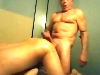 Daddy in sauna fucks and cums in young guy's ass