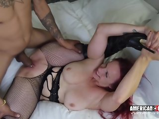 Bella Rossi is offering her fuckholes to a group of horny guys, because she wants a gangbang